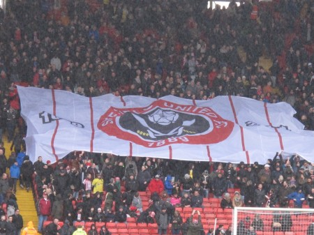 Blades fans pass around a banner to welcome their team.