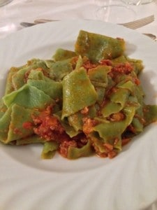 Fresh pasta with nettles, sauce of meat and tomatoes.