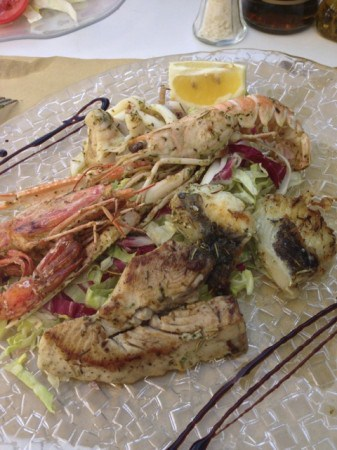 Mixed seafood grill from a restaurant on the beach in Monterosso al Mare, Cinque Terre.