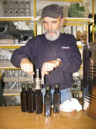 Bottling olive oil in Tuscany.
