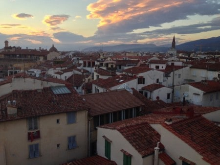 Sunset during rooftop dining in Florence. Read all about Italian hiking and eating at paulgerald.com.