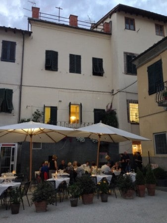 Dinner in a square in Lucca, Tuscany. Read all about Italian hiking and eating at paulgerald.com.