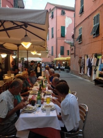 Sitting down for a dinner on the street in Cinque Terre, Italy. Read all about Italian hiking and eating at paulgerald.com.
