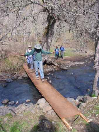 Crossing Catherine Creek on a fun, bouncy bridge.