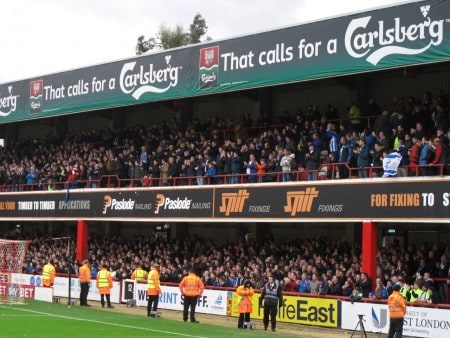 Away fans at Griffin Park.