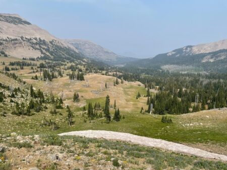 A view of mountains and a valley from Bighorn Pass in Wyoming.